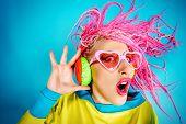 stock photo of dreadlock  - Crazy expressive trendy DJ girl in bright clothes - JPG