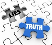 stock photo of honesty  - Truth word on a puzzle piece to fill a hole of lies in a puzzle to illustrate sincerity - JPG