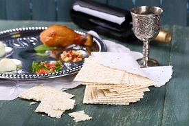 foto of seder  - Matzo for Passover with Seder meal and wine on plate on table close up - JPG
