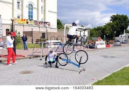 Timur Ibragimov and Mikhail Sukhanov's performance champions of Russia on a cycle trial. City Day of Tyumen, Russia on July 26, 2016