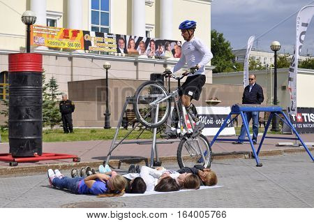 Timur Ibragimov performance champions of Russia on a cycle trial. City Day of Tyumen, Russia on July 26, 2016