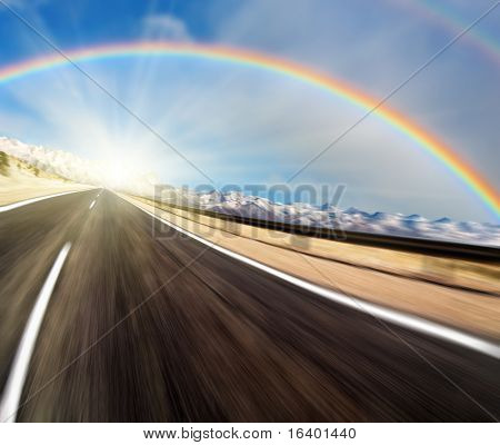 Road with motion blur and rainbow