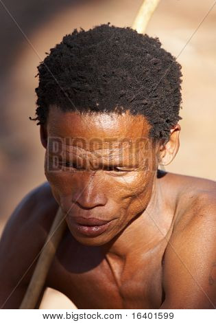 NAMIBIA- MAY 6: Portrait of bushman hunter May 6, 2007 in Namibia, Kalahari Desert. Bushmen are an indigenous people of southern Africa living in Namibia, Botswana and some another countries