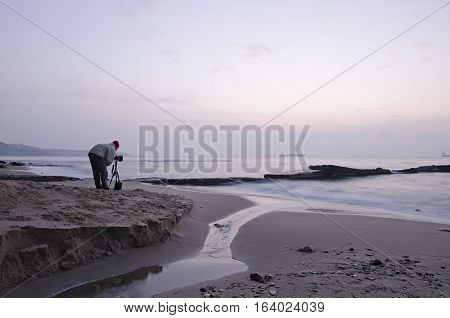 Photographer takes pictures panorama of the sea seaside