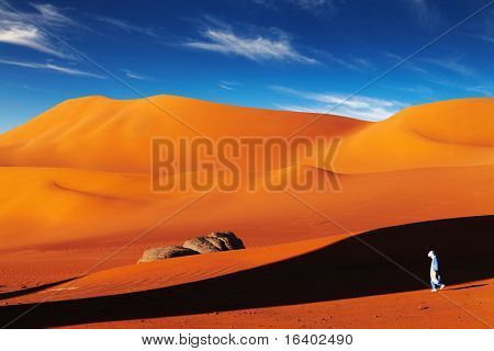 Tuareg in desert at sunset, Sahara Desert, Algeria