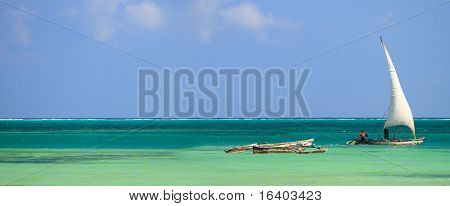 Panoramic photo of tropical ocean waters and traditional Zanzibar boats