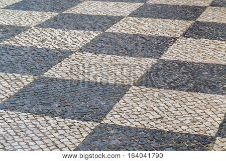 Old town center street stone brick pavement. roadway in Portugal.