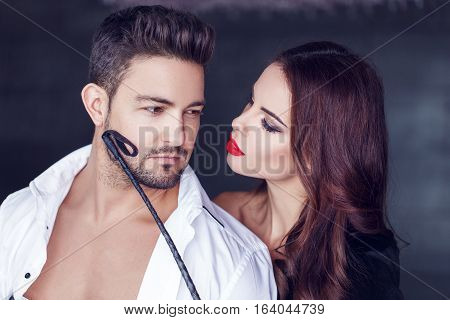 Sexy woman foreplay with rich man by whip seduction and sensuality