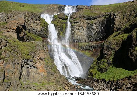 Waterfall with Rainbow in Iceland. Northern Europe