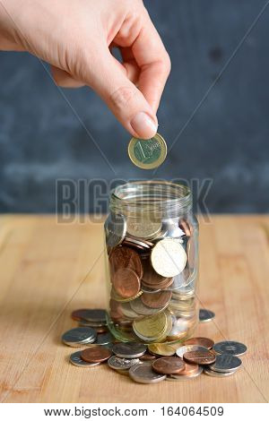 Retirement plan concept illustrated with coins and a jar