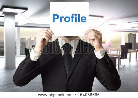 businessman in office hiding face behind sign profile