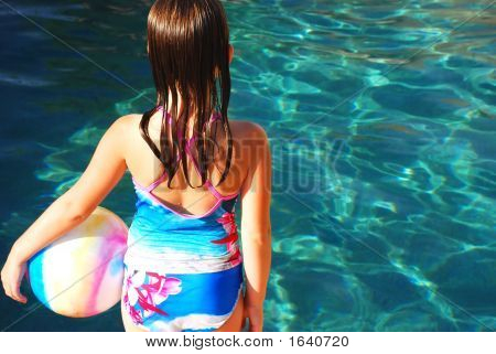 Girl With Ball By Pool