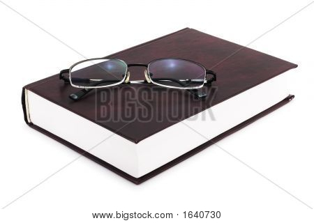 Book With Eyeglasses On White (Include Clipping Path)