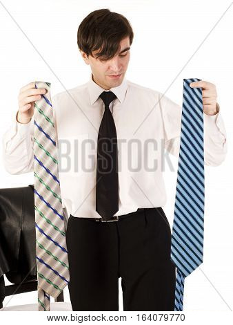 young brunette handsome guy having choice between two ties isolated on white background, lifestyle business people concept close up