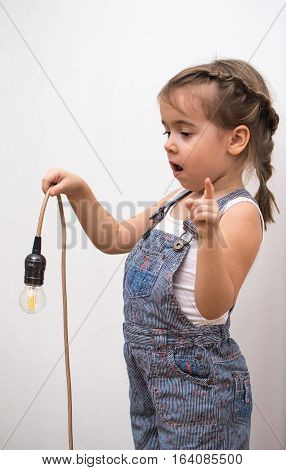Little Cute Girl With Light Bulb In Hand