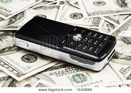 Mobile Phone On Dollars Background