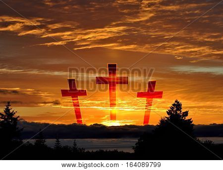 Three crosses symbolizing Jesus crucifixion, in a sunset sky., with dark water and trees in the foreground.