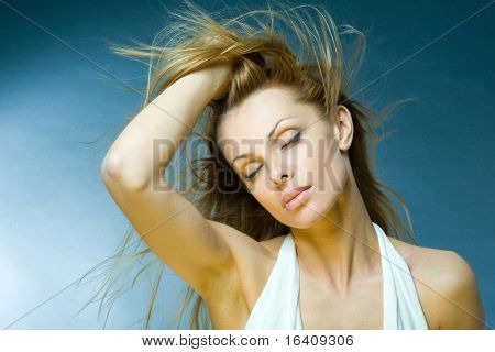 Portrait of a beautiful young woman enjoying the wind