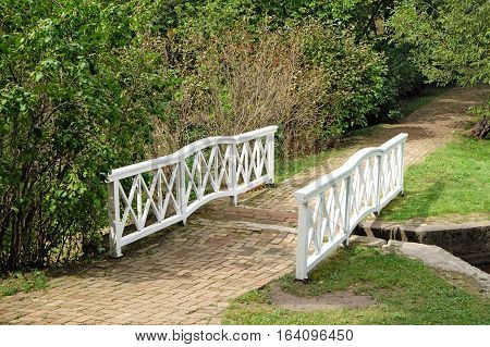 TARKHANI RUSSIA - AUGUST 28 2016: Bridge through the channel between the two ponds in the Lermontov estate Tarkhany