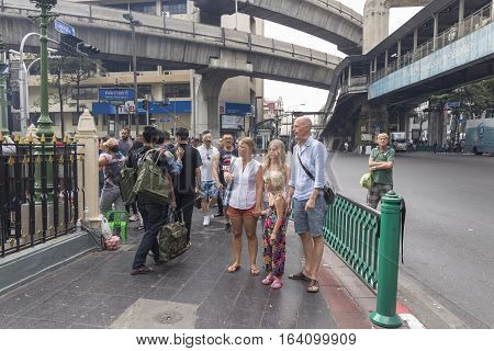 BANGKOKTHAILAND - DEC 31 : tourist scene at outside of Erawan shrine while new year festival on december 31 2016 Thailand. Erawan shrine is famously sacred place in Ratchaprasong area