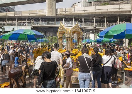 BANGKOKTHAILAND - DEC 31 : scene of Unidentified tourist worship in Erawan shrine in ratchaprasong area while new year festival on december 31 2016 Thailand. Erawan shrine is famous place for tourist