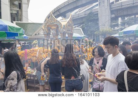 BANGKOKTHAILAND - DEC 31 : snapshot of people worship in Erawan shrine while new year festival on december 31 2016 Thailand. Erawan shrine is famously place in ratchaprasong area