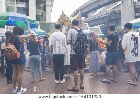 BANGKOKTHAILAND - DEC 31 : incense smoke scene of worship in Erawan shrine in ratchaprasong area on december 31 2016 Thailand. there are many tourist worship at Erawan shrine in new year festival