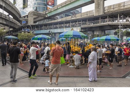 BANGKOK THAILAND - DEC 31 : view of Unidentified tourist inside Erawan shrine while new year festival on december 31 2016 Thailand. Erawan shrine is famously place in ratchaprasong area