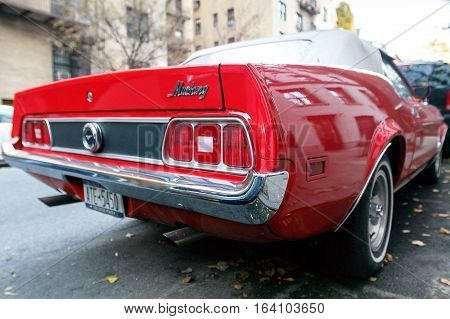 New York November 28 2016: A classic red Ford Mustang is parked in the street in Manhattan.