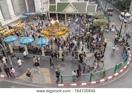 BANGKOKTHAILAND - DEC 31 : scene of Unidentified crowd in Erawan shrine at Ratchaprasong Junction while new year festival on december 31 2016 Thailand.
