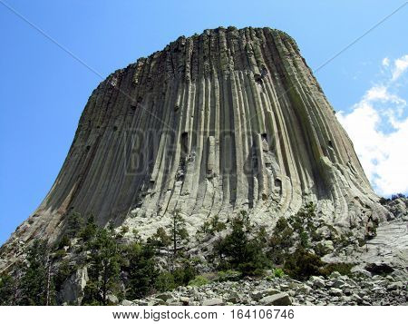 Devils Tower National Monument under a blue sky
