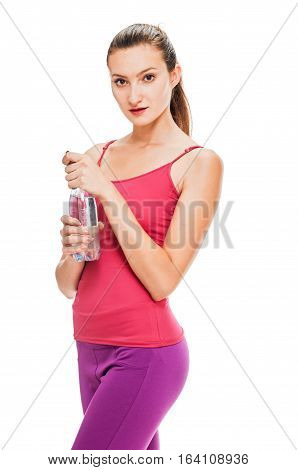 Fitness woman with bottle of water on white background.