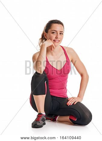 fitness girl in gym dress sitting on white background
