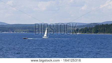 BALTIC SEA, SWEDEN ON JULY 25. View of a sailboat, motorboat and the seaside by the coast on July 25, 2013 at the Baltic Sea, Sweden. Unidentified people. Editorial use.
