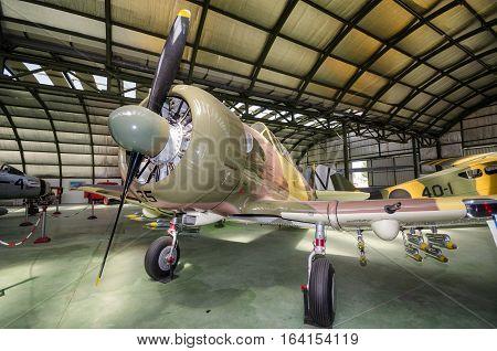 Madrid Spain - September 5 2015: Interior of an hangar with some rare vintage interceptor airplanes on September 52015 in Madrid air museum Spain.