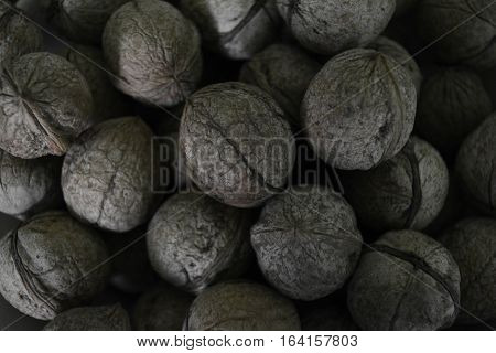 walnuts in shell, walnut shell texture,  crop of nuts
