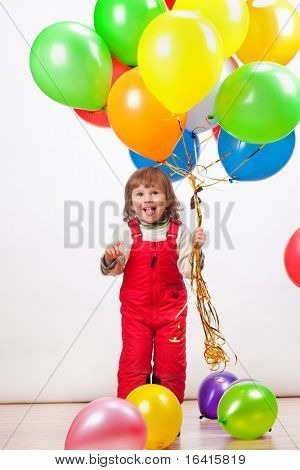 little girl in red with balloons