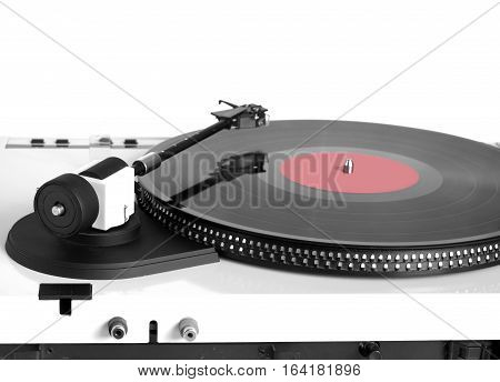 Turntable in silver case with rotation vinyl record with red label isolated on white background. Horizontal rear view closeup