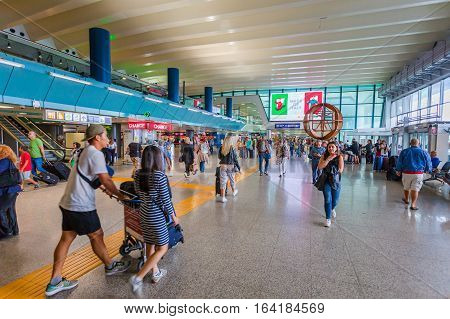 ROME, ITALY - September  15, 2016:  Passengers in Fiumicino Airport.  Fiumicino - Leonardo da Vinci International Airport is a major international airport in Rome, Italy
