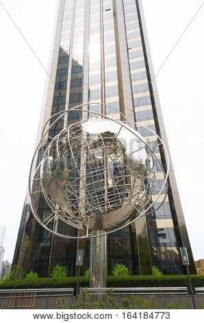NEW YORK - APRIL 28 2016: Columbus Circle is a heavily trafficed intersection and the point from which all official distances from NYC are measured