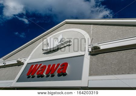 Absecon NJ December 10 2016: A Wawa convenience store on New Jersey route 30. Wawa Inc is a chain of convenience store/gas stations located along the East Coast of the United States.