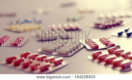 Many different capsules per pack in white background