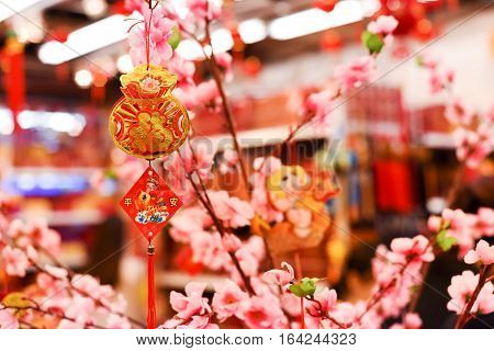 Chinese decorations. Traditional Chinese new year decorations. Flowers background.