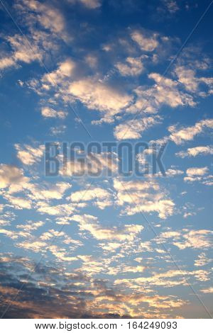 Beautiful celestial sunset with white clouds high in the stratosphere in the evening. Vertical view