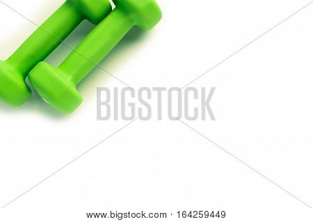 Green dumbbells for fitness isolated on white background.