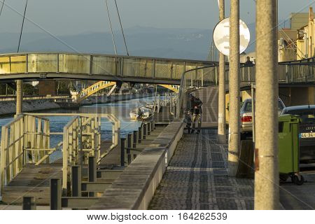 AVEIRO PORTUGAL - April 24 2016: Street scene showing bridges over the central canal in Aveiro Portugal.