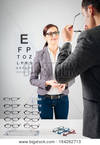 Customer trying new glasses at the optician's.