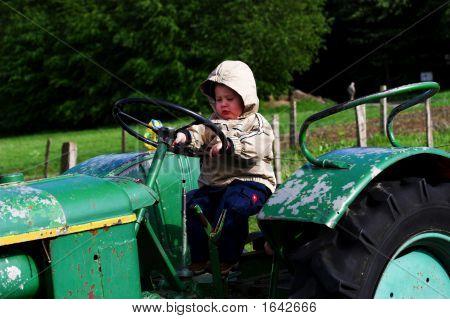 Boy On A Tractor