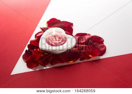 Candle Heart On The Heart Of Rose Petals Corner Red White Background With Space For Text
