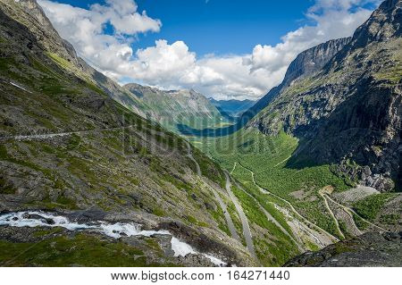 Trollstigen rocky canyon with scenery narrow mountain road and water streams, Norway national touristic route.